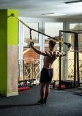Man With Nude Torso, And Muscular Back In Gym Enjoy Training, Trx. Man With Torso, Sportsman, Athlet poster