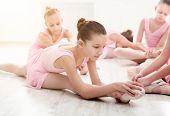 Little Ballerinas In Ballet Studio. Group Of Girls Having Break In Practice, Sitting On Floor. Class poster