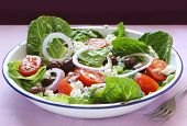 image of romaine lettuce  - Greek salad in old enamel bowl - JPG