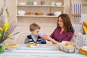 Mother Feeds Her Son, Happy Family Breakfast. Mother And Son Having Breakfast. Happy Mother And Son  poster