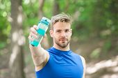 Towards A Healthier Lifestyle. Athlete Drink Water After Training In Park. Man Athletic Appearance H poster