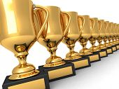 stock photo of game_over  - Many gold trophies in a row over white background - JPG