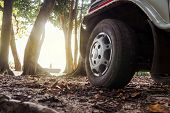 Car Wheels On A Road. Off-road Tire. Outdoor, Adventures And Travel Suv. Close-up Of Car Wheel On Ro poster