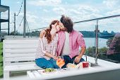 Future Wife. Curly Bearded Man Kissing His Future Wife Having Romantic Dinner On Beautiful Summer Te poster