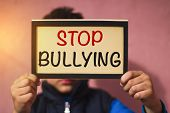 Little Boy Holding Cardboard With Text Stop Bullying - Victim Children Bullied Abuse Concept poster