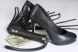 stock photo of flogging  - Strict Black Leather Flogging Whip high heels shoes and money on white background - JPG