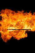 image of truncheon  - Burning flame or fire isolated on black background - JPG