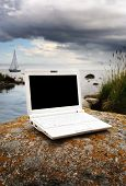 pic of sail-boats  - Photo of a white laptop in the natur with a sailing boat in the background - JPG