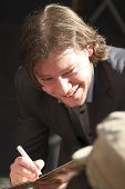 Martijn Smit Smiling And Signing A Cd Cover