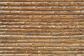 image of log fence  - Wall of the rural house made from wooden logs - JPG