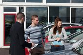 Man concluding a contract in a dealership