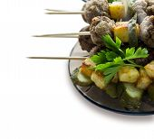 Background with roast meatballs on skewers