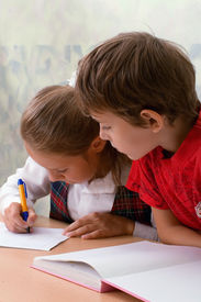 picture of little school girl  - A School children sitting at classroom - JPG