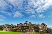 stock photo of mayan  - A wide angle view of showing the entire palace at the Mayan ruins of Palenque in Chiapas Mexico - JPG