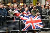 LONDON - UK, APRIL 17: The crowd waits for Baroness Thatcher funeral procession on Ludgate Hill, on April 17, 2013 in London.