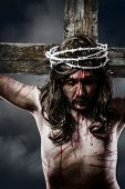 stock photo of sacred heart jesus  - Jesus Christ with crown of thorns white on the cross of Calvary representation - JPG