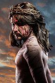 calvary jesus, man bleeding, representation of passion with blue light halo