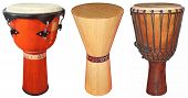 stock photo of congas  - Three wooden jembe drums isolated on white background - JPG