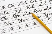 stock photo of cursive  - Example of cursive writing with a pencil Learning cursive writing - JPG