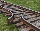stock photo of train track  - Strategy obstruction challenges with a train track that is broken as a business concept of a road block and finding solutions to obstacles that are dangerous and challenging as journey on a strategic goal - JPG