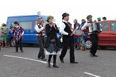 HASTINGS, ENGLAND - MAY 7: The Miscellany Dance Group take part in a parade on the West Hill at the