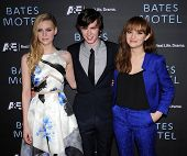 LOS ANGELES - MAR 12:  Nicola Peltz , Freddie Highmore & Olivia Cooke arrives to the A&E Network Premiere of