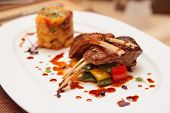 Grilled rack of lamb with mashed potatoes and vegetables