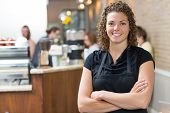 pic of self-employment  - Portrait of happy mid adult female owner standing arms crossed in cafe - JPG