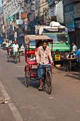 Cycle Rickshaw Driver With Passenger In Chawri Bazar, Delhi Early Morning
