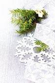 Christmas Tree Branch And White Christmas Decorations On Soft Grey Background. Christmas Time Card.