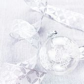 Christmas Ornaments With White Bauble  And Silver Ribbon Close Up. Bright Christmas Card. White Chri