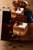 Coffee cream  small cakes and chocolate truffle cakes