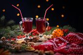 fir branches, two glasses of mulled wine on a wooden table