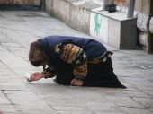 foto of peddlers  - Beggar woman on the street of Venice Italy Europe - JPG