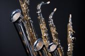 Saxophones Set Of Four Isolated On Black