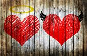 picture of good-vs-evil  - Valentines day background wih two hearts  - JPG