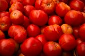 stock photo of farmers market vegetables  - Ripe summer red tomatoes sold in the Baton Rouge Farmers Market - JPG