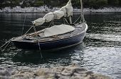 Sailing Boat Anchoring With Landlines Moored To Shore
