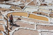 MARAS, PERU - JULY 23: woman at Maras salt mines in the peruvian Andes at Cuzco Peru on july 23, 201