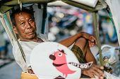 Thai rickshaw driver