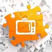 stock photo of televisor  - TV Set Icon on Orange Puzzle - JPG