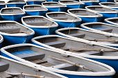 foto of fleet  - A rental row boat fleet is tied together at the end of the day - JPG