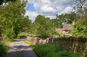 Cotswold Lane With Cottage
