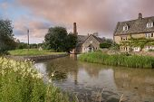 stock photo of slaughter  - The old mill at Lower Slaughter near Bourton on the Water - JPG