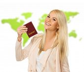 Happy blond woman with passport against world map