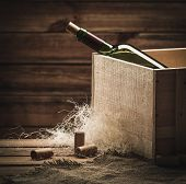 Bottle of wine in box in wooden interior