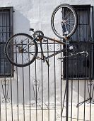 Old bicycles parked and locked to metal gate in Williamsburg, Brooklyn