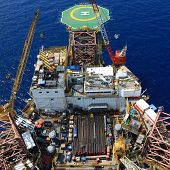 stock photo of rig  - Top View of Offshore Drilling Rig Towards The Helideck - JPG