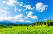 Beautiful landscape of valley in Alpine mountains, small houses in Seefeld, rural scene, majestic pi