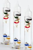 stock photo of galileo-thermometer  - Three water Galileo thermometers with colorful globes in liquid - JPG